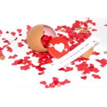 Confettis coeur badge et message personnalisé dans un oeuf